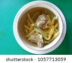 daylily soup with pork in a... | Shutterstock . vector #1057713059