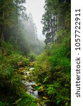 a beautiful water stream while... | Shutterstock . vector #1057722911