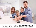 family ringing service bell on... | Shutterstock . vector #1057729967