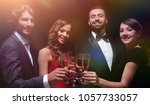cheerful people celebrating a... | Shutterstock . vector #1057733057