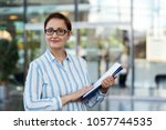 business woman holding...   Shutterstock . vector #1057744535