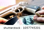 hand guns with bullets  and... | Shutterstock . vector #1057745201
