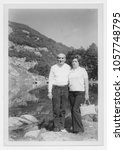 happy couple in mountain in 1950 | Shutterstock . vector #1057748795