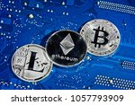 Small photo of Shining silver metal BTC LTC ETH Bitcoin Litecoin Ethereum coins on computer mother board