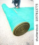 Small photo of Roll of green plastic sunshade prepare for cut in the local shop.