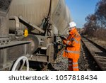a railway worker in high... | Shutterstock . vector #1057818434