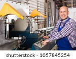 middle age worker at... | Shutterstock . vector #1057845254