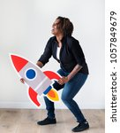 Small photo of African descent woman holding rocketship icon