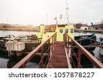Fishing Boats Docked At A Pier...