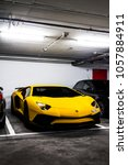 Small photo of Geneva, Switzerland - March 2018: yellow Lamborghini Aventador LP750-4 SuperVeloce supercar parked in a luxury hotel underground car park in central Geneva. Only 600 of these cars were produced.