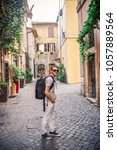a young male tourist in... | Shutterstock . vector #1057889564