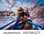 hipster woman is sightseeing... | Shutterstock . vector #1057891277
