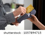 young man using bank terminal...   Shutterstock . vector #1057894715