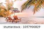 beautiful sunset beach scene....   Shutterstock . vector #1057900829