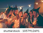 group of young friends having a ... | Shutterstock . vector #1057912691
