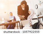 disabled arab woman in hijab in ... | Shutterstock . vector #1057922555