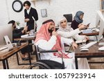 disabled arab man in thawb in... | Shutterstock . vector #1057923914