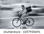 delivery on the bike in traffic ... | Shutterstock . vector #1057930691