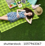 young smiling woman relaxing... | Shutterstock . vector #1057963367
