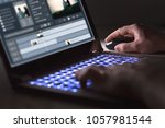 video editing with laptop.... | Shutterstock . vector #1057981544