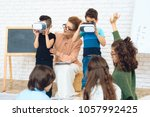 Small photo of Little schoolchildren get acquainted with technology of virtual reality. Children's acquaintance of with high technologies.