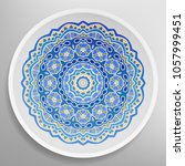 decorative plate with round... | Shutterstock .eps vector #1057999451