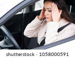 closeup shot of stressed young...   Shutterstock . vector #1058000591