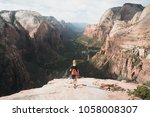 zion np  utah  usa  girl hiking ... | Shutterstock . vector #1058008307