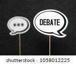Small photo of Debate, dialog, communication and education concept. Talking about political opinions. Two cardboard speech bubbles.