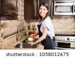 portrait of cute hispanic woman ... | Shutterstock . vector #1058012675