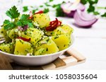 boiled potato slices with green ...   Shutterstock . vector #1058035604