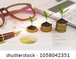 growth plants on stack of coins ... | Shutterstock . vector #1058042351