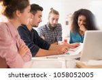 in the office. meeting around a ... | Shutterstock . vector #1058052005