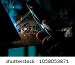 welder closeup hand   Shutterstock . vector #1058053871