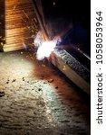 welder closeup spark   Shutterstock . vector #1058053964