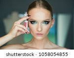 woman with lipstick  cosmetics. ...   Shutterstock . vector #1058054855