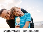 boy eating an ice cream... | Shutterstock . vector #1058060081