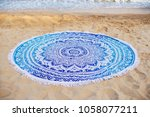 a round towel lies on the sand... | Shutterstock . vector #1058077211