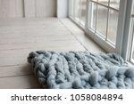 a blanket made from merino wool.... | Shutterstock . vector #1058084894