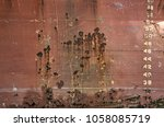 reddish brown ship hull with... | Shutterstock . vector #1058085719