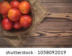 blood orange fruit in a wicker... | Shutterstock . vector #1058092019