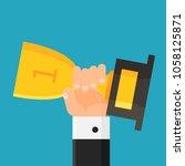 hand holding trophy. winner.... | Shutterstock .eps vector #1058125871