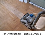 sanding hardwood floor with the ... | Shutterstock . vector #1058169011