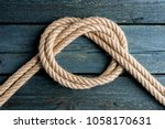 overhand bow knot. rope node | Shutterstock . vector #1058170631