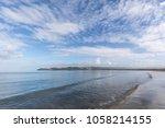 Small photo of Mahia Beach at dawn. Mahia is a super popular holiday resort destination in New Zealand