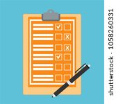 clipboard with checklist icon.... | Shutterstock .eps vector #1058260331