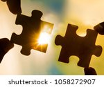 two hands trying to connect... | Shutterstock . vector #1058272907