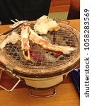 Small photo of Alaska king crab, Crabs grill on the hot stove charcoal, Tokyo, Japan