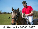 handsome male horse rider on... | Shutterstock . vector #1058311877