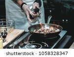 the chef cooks the small... | Shutterstock . vector #1058328347
